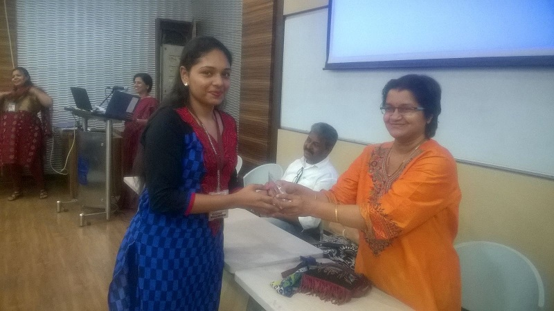 Ms. Chital receiving a prize