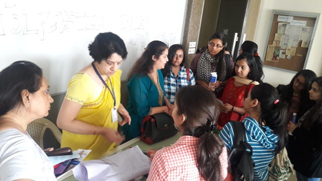 Dr. Gayatri interacting with students and staff 1