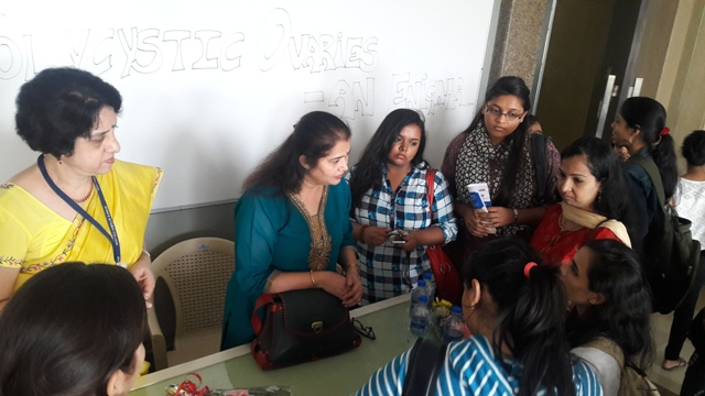 Dr. Gayatri interacting with students and staff 2